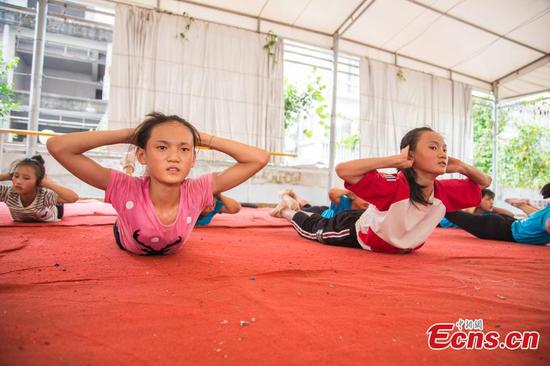 Acrobatics seen as way out of poverty in Guangxi