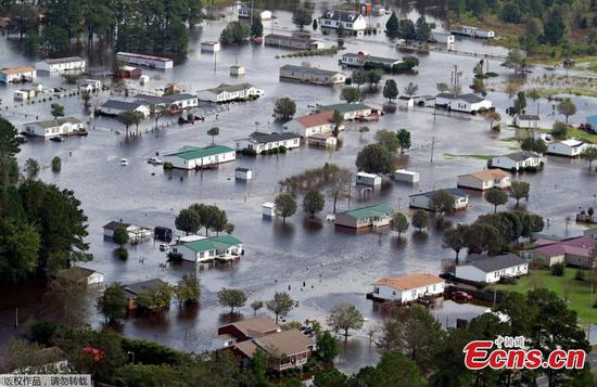 As floodwaters rise, Florence devastates North Carolina